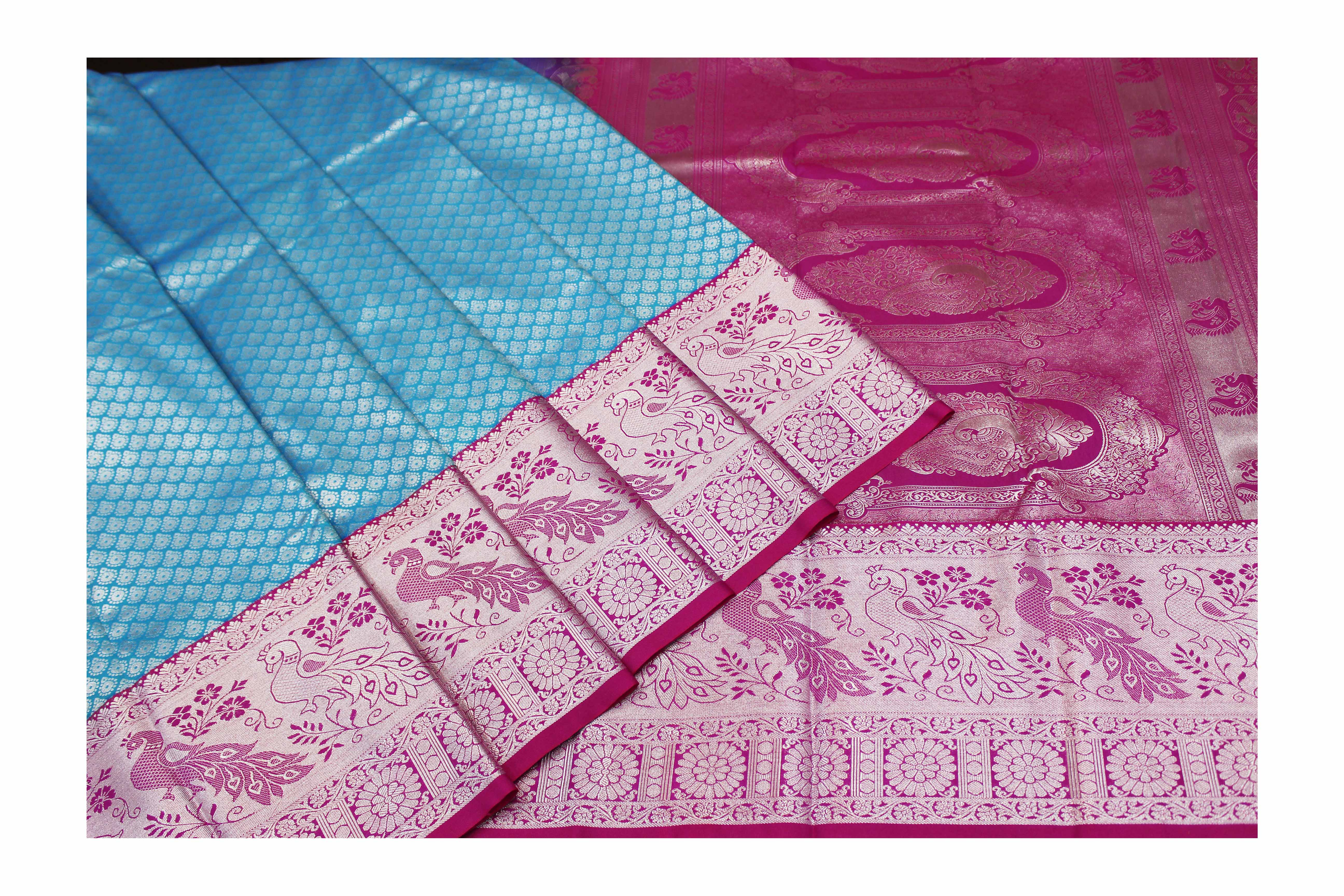 mixture of turquoise blue and pink raw silk with silver jari.