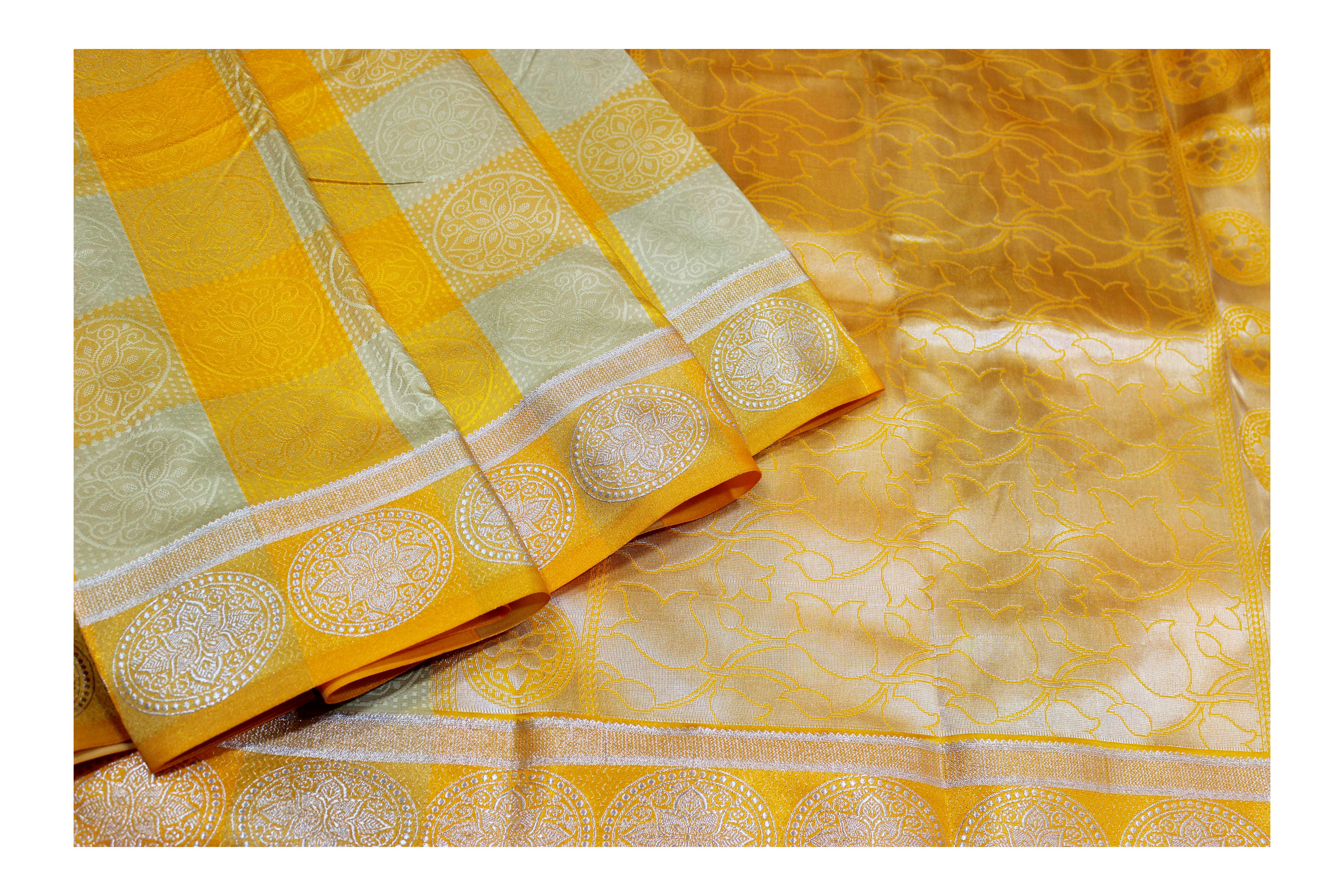Mixture of yellow and pearl white saree with silver jari.